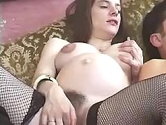 Pregnant cutie and whore share cock